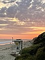 Life guard station at beach during sunset.jpg