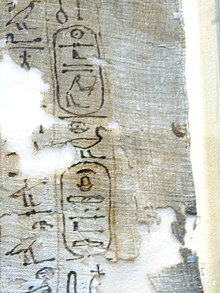 Fragment of the death shroud of Ahmose bearing Seqenenre Tao's titulary, Museo Egizio