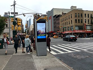 LinkNYC - A LinkNYC kiosk at 23rd Street and Eighth Avenue, with side advertising panel