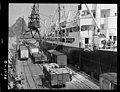 Loading Taranaki produce from railway wagons into overseas ship, Cumberland at New Plymouth. View from platform of crane.jpg