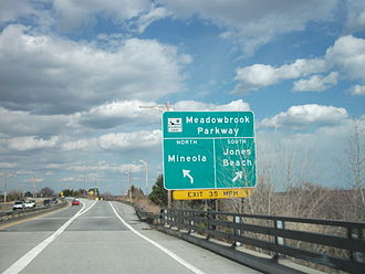 Loop Parkway - The Loop Parkway eastbound at the junction with the Meadowbrook in Freeport