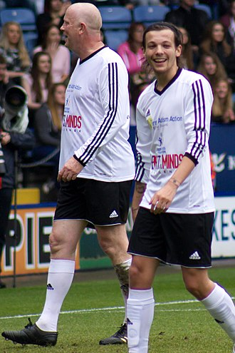 Louis Tomlinson - Tomlinson with Mark Wright at Niall Horan Charity Football Challenge, 2014.