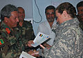 Lt. Karie Basso receives an Afghan National Army Certificate (4446765543).jpg