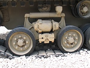 Horstmann suspension - The horizontal volute spring suspension used on late-model Sherman tanks was a Horstmann design. The two wheels per bogie, two crank arms, springs between the cranks and single mounting point are all evident. This model also includes a shock absorber for further improvements in ride quality.
