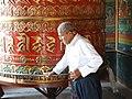 Man Turns Prayer Wheel - Monastery at Boudhanath - Outside Kathmandu - Nepal (13967741195).jpg