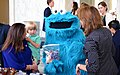 Martha Roby holds her 4-year-old son, George, as they greet Sesame Street's Cookie Monster.jpg