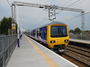 Mauldeth Road railway station - A half-hourly Northern Class 323 service departs from Mauldeth Road in 2013.