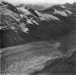 McCarty Glacier, terminus of tidewater glacier, hanging glaciers with icefall on the mountainside, September 4, 1977 (GLACIERS 6633).jpg