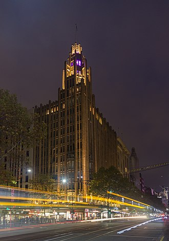 Manchester Unity Building - The building viewed from ground level at night.