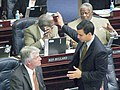 Michael Grant confers with Marcelo Llorente on the House floor.jpg