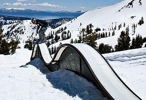 Skiboarding - Skiboarder sliding a box.