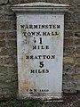 Milepost at Parsonage Farm - geograph.org.uk - 343843.jpg