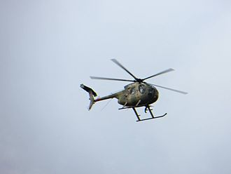 Kenya Defence Forces - A MD 500 Defender helicopter over the Westgate Shopping Mall during the siege, 2013.