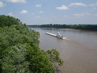 A barge travels North on the Missouri River at Highway 364 in Saint Charles, Missouri. Missouri river at hwy 364.jpg