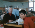 Mohammad Reza Shah and Crown Prince Reza at a public restaurant in Switzerland 1970.png