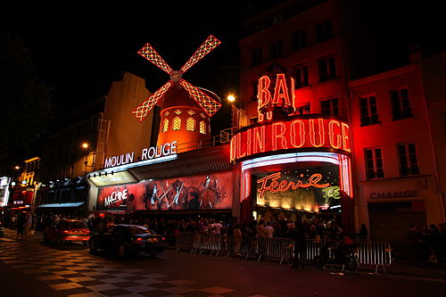 The Moulin Rouge at midnight Moulin Rouge, Paris April 2011.jpg