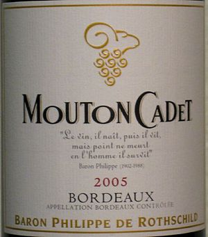 """Mouton Cadet - Label detail: the poem by Baron Philippe reads, """"Wine, it is born, then it lives, but die it does not, in man it lives on."""""""