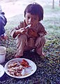 NARA 111-CCV-144-CC44660 Vietnamese girl eating food provided by American soldiers 1967.jpg