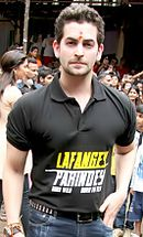 Mukesh in black, short-sleeved shirt
