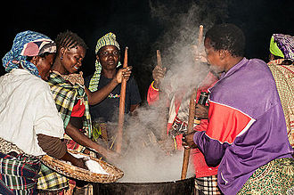 Ugali - Yawo women preparing ugali for a large gathering.
