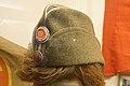 """Norway in WW2. Side cap for female officer-leader in the Norwegian Labour Service (""""båtlue for kvinnelig kontrollbefal i NS' Arbeidestjenesten, AT""""). Lofoten Krigsminnemuseum 2019-05-08 DSC00091.jpg"""