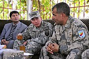 Officials meet near the 'friendship bridge' border crossing between Mangusar, Uzbekistan and Hairatan, Afghanistan