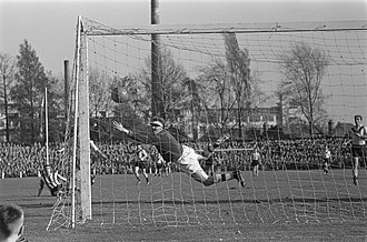 Philips Stadion - Coen Dillen scores for PSV. On the background, the situation of the stands in 1959 can be seen.