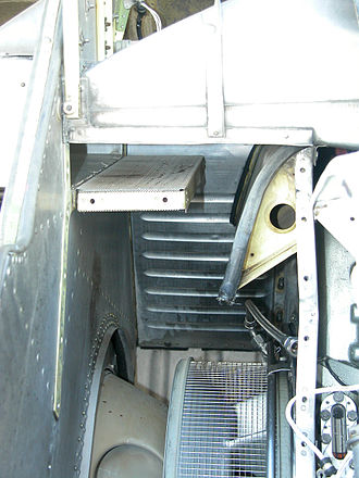 Foreign object damage - FOD deflection system on a PT6T installed on a Bell 412. Air enters from upper right, and pure air follows the curved ramp down to the compressor inlet (also covered by a screen). Any debris being sucked in will have enough momentum that it will not make such a sharp bend, and will hit the screen on the upper left, and will be carried out to the left, getting blown overboard.