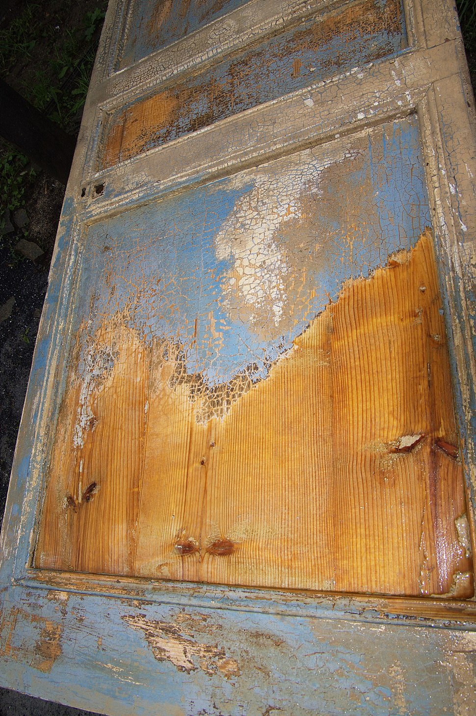 Paint stripping with caustic soda