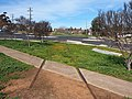 Part of the Eugowra railway line in Cowra passing through a footpath and roundabout August 2020.jpg