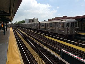 6 (New York City Subway service) - A train made of R62A cars in 6 local service leaving Buhre Avenue, bound for Pelham Bay Park.