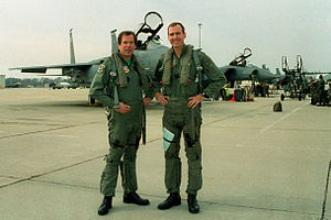 Peter Jennings - Jennings in a flight suit with Lt. Col. Charlie Heald before a flight in a F-15E Strike Eagle in February 1994