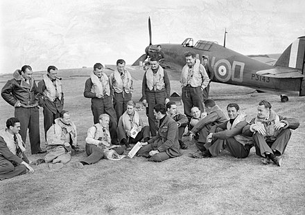 Following the German occupation of Czechoslovakia and formation of the Protectorate of Bohemia and Moravia within Nazi Germany, exiled Czechs fought alongside Allies of World War II, such as No. 310 Squadron RAF. Pilots of No. 310 (Czechoslovak) Squadron RAF in front of Hawker Hurricane Mk I at Duxford, Cambridgeshire, 7 September 1940. CH1299.jpg