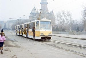 Timișoara: Timiș-2 railcar 252 with a sidecar in use on line 1 with the red line number, 1987