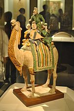 Polychrome glazed tomb figurine of a troupe of musicians on a camel, NMC.jpg