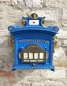 Copy of a letter box of Deutsche Post from the year 1896 in Erfurt. The mailbox is emptied regularly.