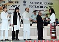 Pranab Mukherjee presenting the National Award for Teachers-2012 to Smt. F. Lalramliani, Mizoram, on the occasion of the 'Teachers Day', in New Delhi. The Union Minister for Human Resource Development.jpg