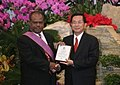 President Chen's Address at the State Banquet Held in Honor of the Prime Minister of the Solomon Islands (22 December 2005), confering the highest diplomatic honor--the Order of Brilliant Stars with Special Grand Cordon upon Kemakeza.jpg