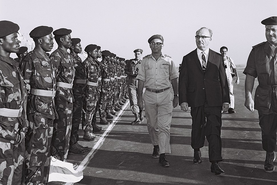 Prime minister Levy Eshkol and chief of staff Zur at graduation ceremony of congolese paratroopers, training base in Israel. September 1963. D772-070