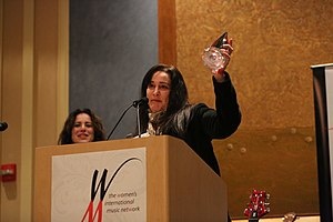 Holly Knight - Knight accepting an award from the Women's International Music Network, 2013
