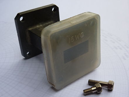 Figure 4. Plastic caps over disconnected flanges prevent dirt and moisture entering the waveguide, in addition to protecting the face of the flange from damage. Protective-plastic-cap-on-waveguide-flange.jpg