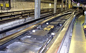 Switches use conventional points on the standard gauge track to guide trains. Rubber tires keep supporting the full weight of the trains as they go through switches. Guideways are provided in order to ensure there are no gaps in the electrical power supply.