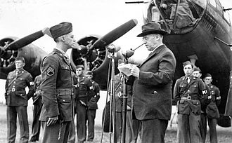 Maynard Harrison Smith - Staff Sergeant Maynard Smith of the 306th Bombardment Group, is presented with the Medal of Honor by Secretary of War Henry L Stimson in front of a B-17 Flying Fortress at Thurleigh Airfield, USAAF Station 111, England.