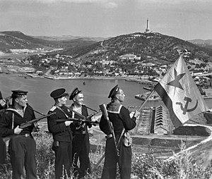 Soviet invasion of Manchuria - Pacific Fleet marines of the Soviet Navy hoisting the Soviet naval ensign in Port Arthur, on October 1, 1945