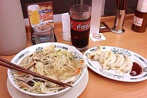 Ramen shop - A ramen dish with gyōza (right) at a Japanese ramen shop