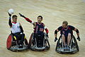 Retired U.S. Sailor William Groulx, center, the U.S. wheelchair rugby team captain, plays defense against a Great Britain player during a match at the Paralympic Games in London Sept 120905-F-FD742-646.jpg