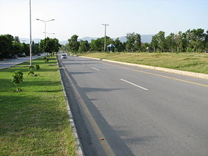 Road next to a park in Islamabad, Pakistan.