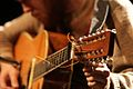 Robin Pecknold tuning his 12 string at the Vogue Theatre.jpg