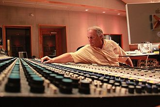 Audio engineer - Noted audio engineer Roger Nichols at a vintage Neve recording console.