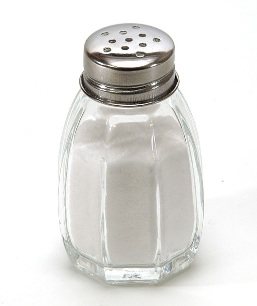 Salt shaker on white background